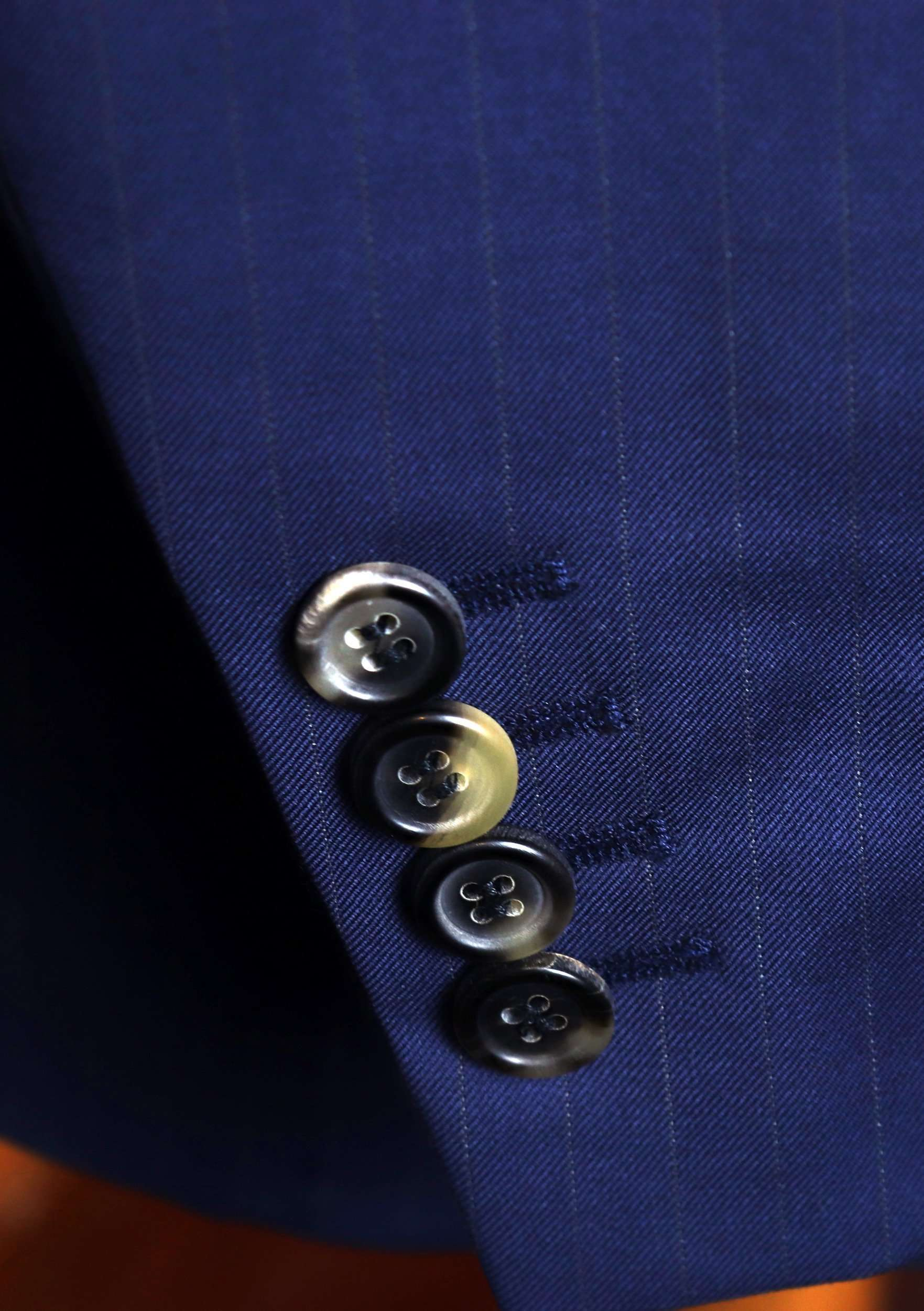 tailored-suits-horn-buttons